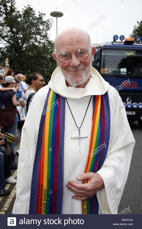 rainbow-stole-and-cross-on-a-priest-at-brighton-and-hove-gay-pride-BHECX3.jpg